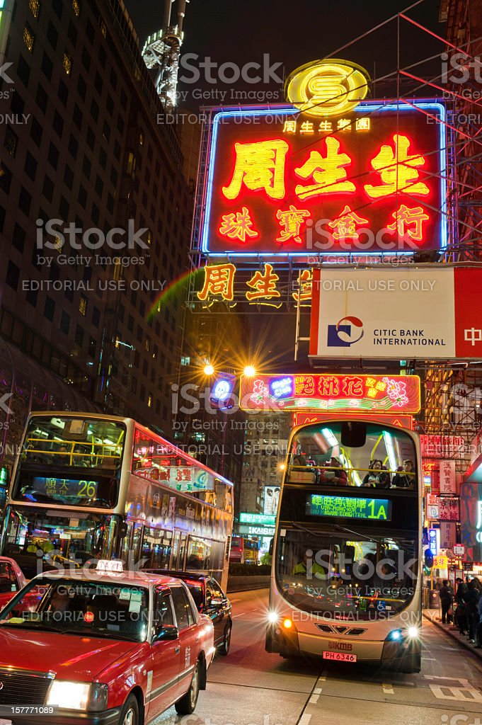 China neon signs night buses Hong Kong stock photo