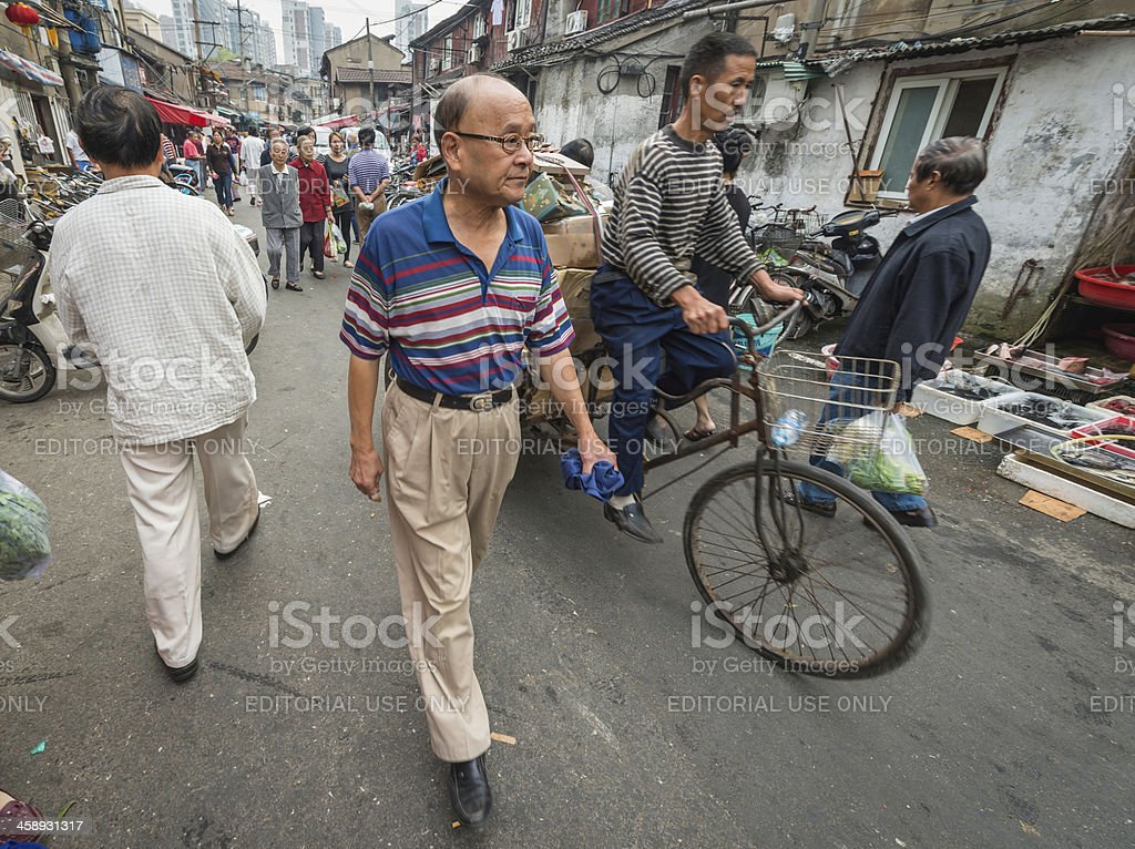 China people in crowded back streets of Shanghai stock photo