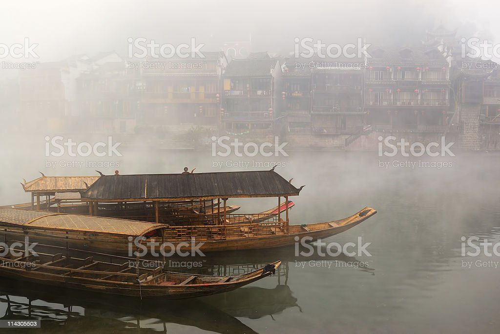 China river landscape with boats and traditional architecture stock photo