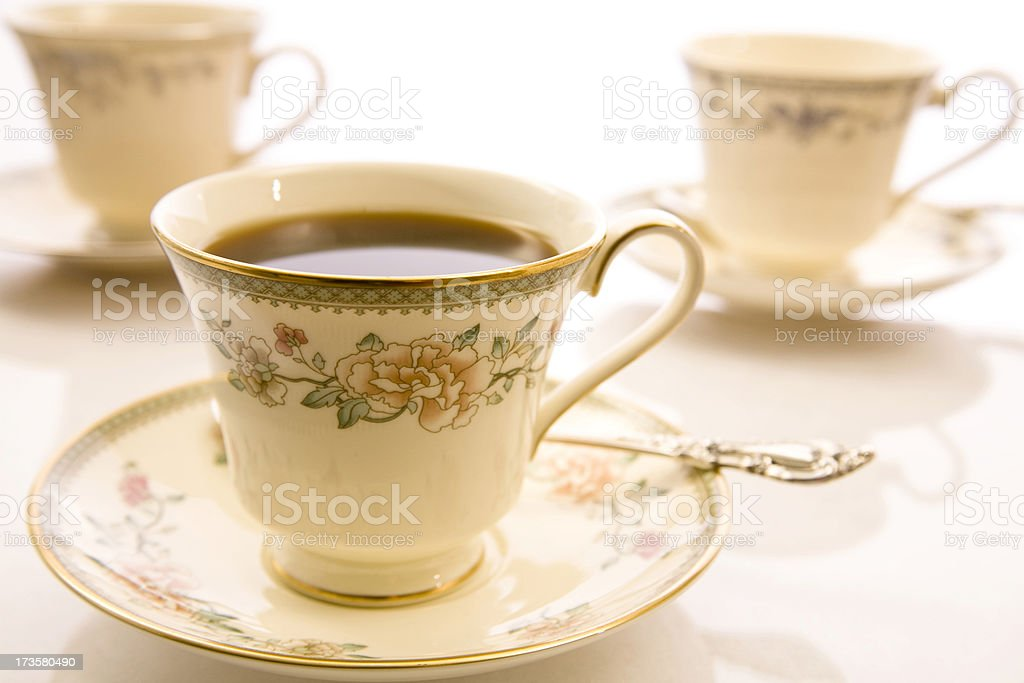 China tea cups and saucers. Silver spoon. royalty-free stock photo