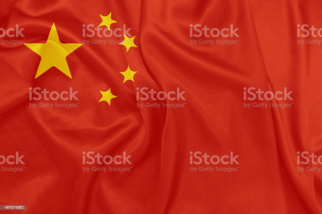 China - Waving national flag on silk texture stock photo