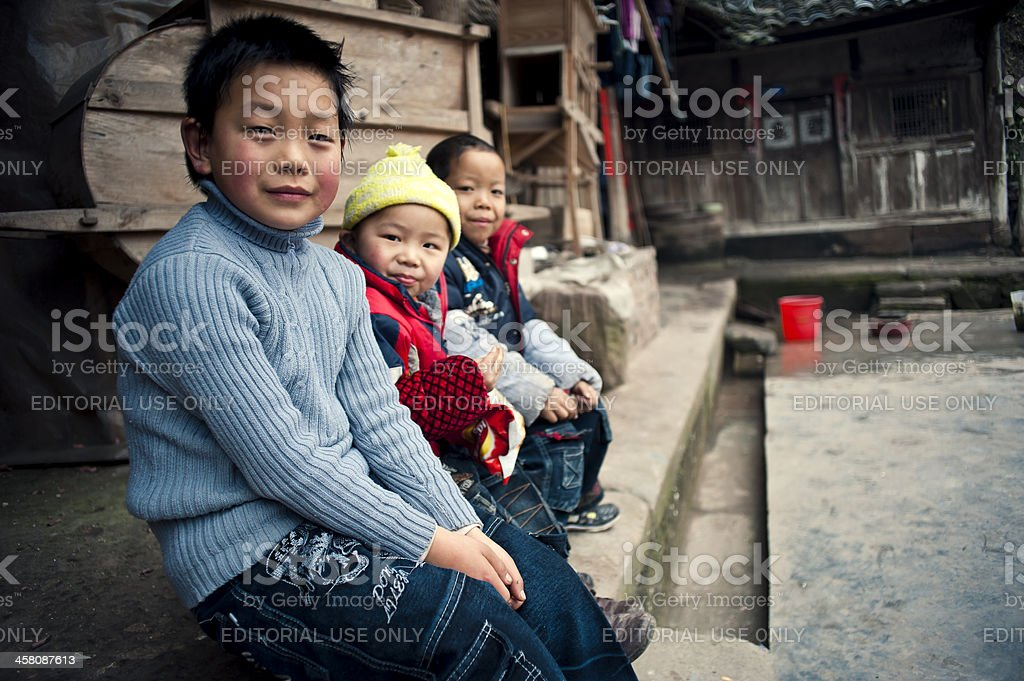 China's rural children sit together stock photo