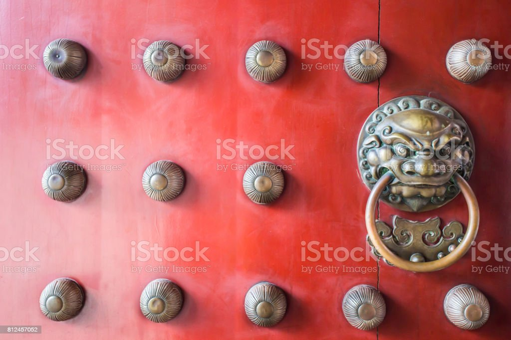 Chinatown traditional red wooden door guardian brass handle stock photo