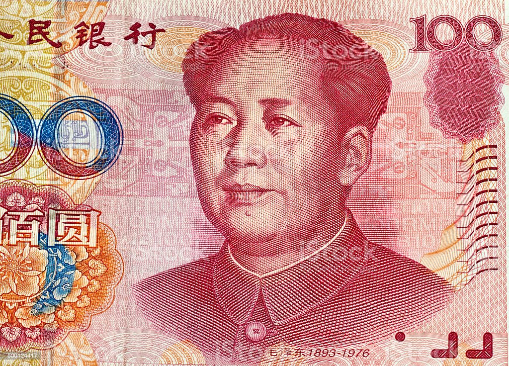 Chinese 100 yuans banknote close up with Mao Zedong portrait stock photo