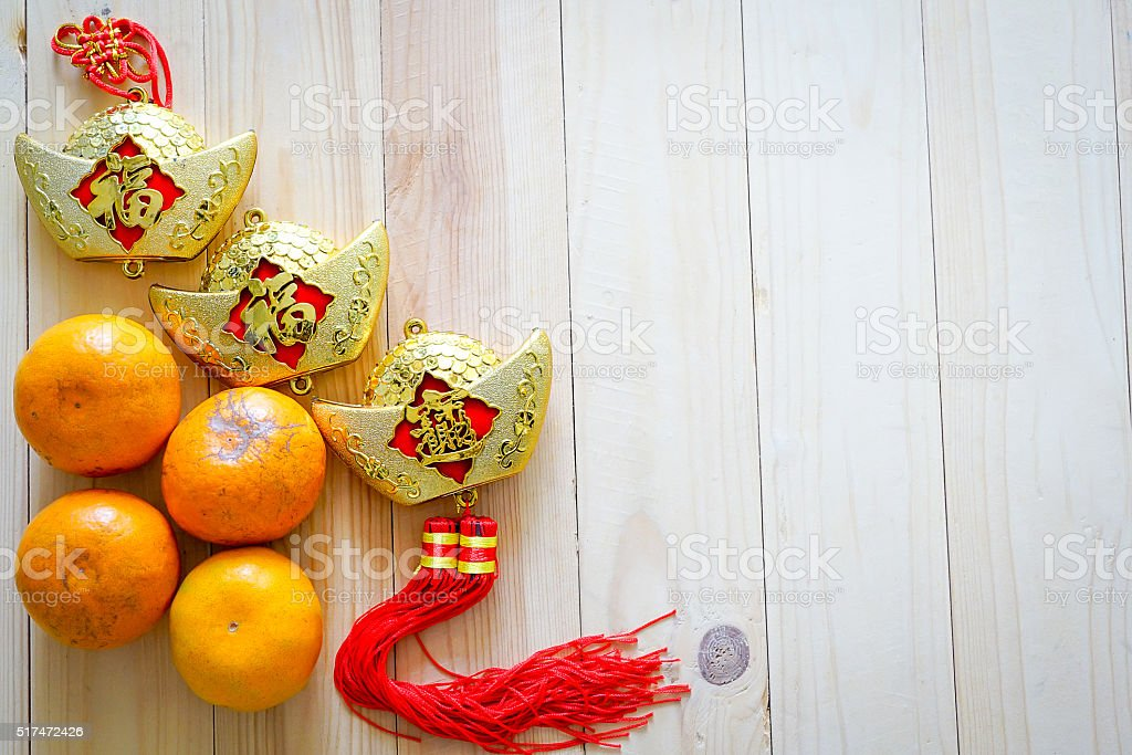 Chinese alphabet and four oranges on the wood floor stock photo