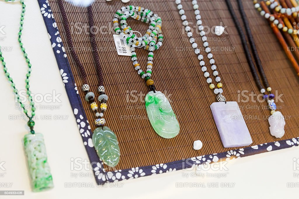 Chinese amulets made of green and blue jade stock photo