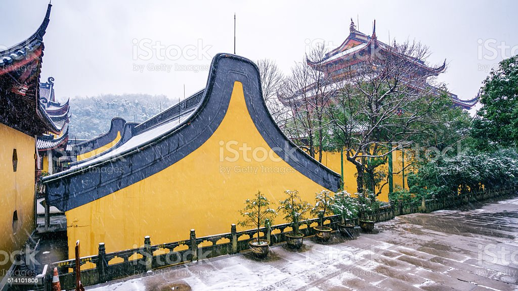 Chinese ancient architecture in snow stock photo