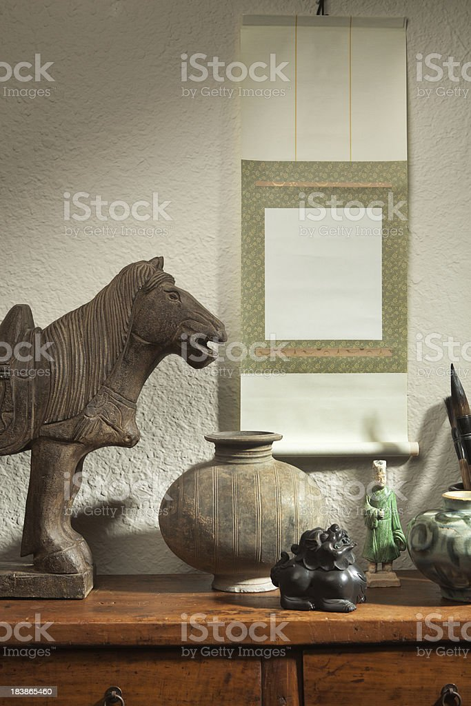 Chinese Antique Potteries Display with Blank Scroll Painting Advertising Sign stock photo