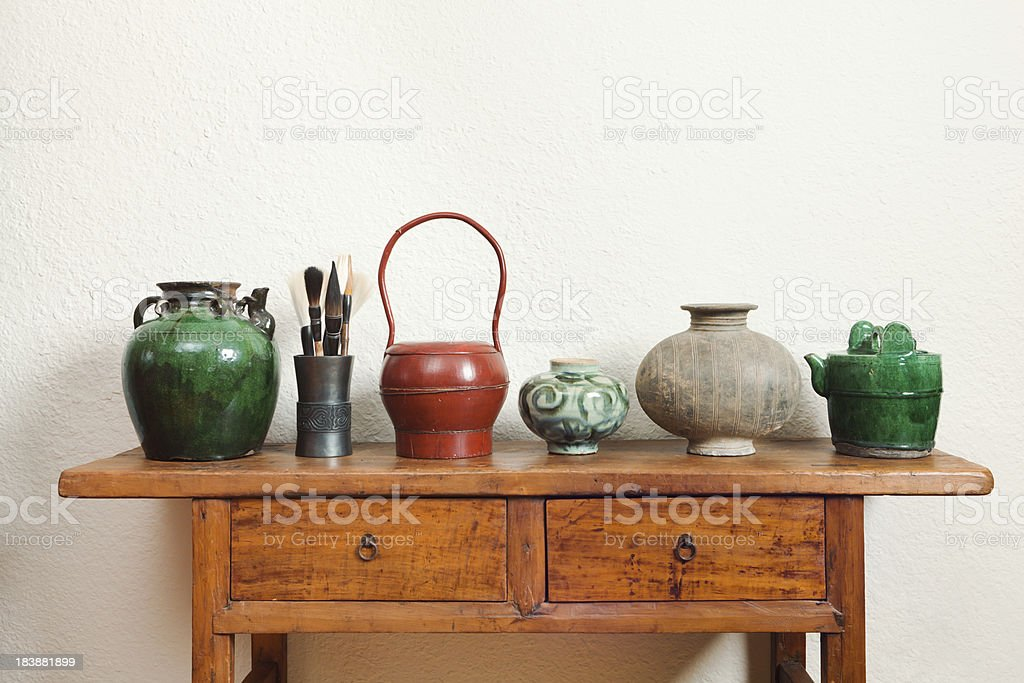 Chinese Antique Store Display of Potteries, Lacqor on Table stock photo