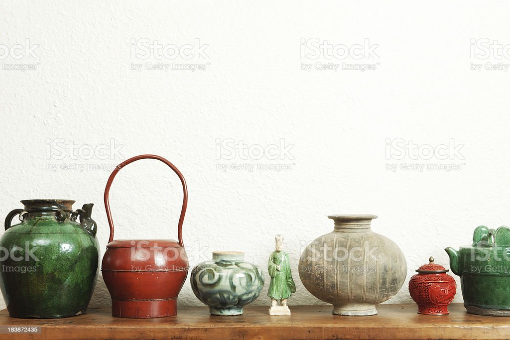 Chinese Antique Store Display of Potteries, Lacquer and Figurine stock photo