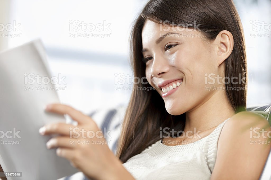 chinese asian / caucasian woman reading royalty-free stock photo