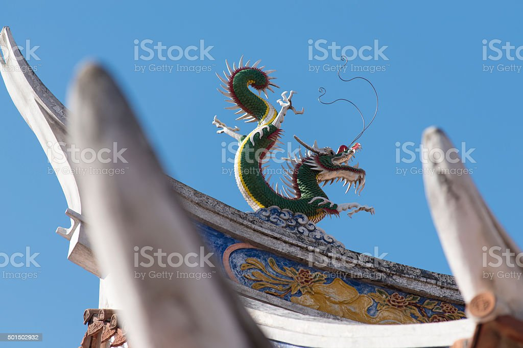 Chinese Auspicious Emerald Dragon on the roof stock photo