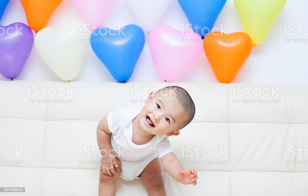 Chinese baby boy and colorful balloons stock photo
