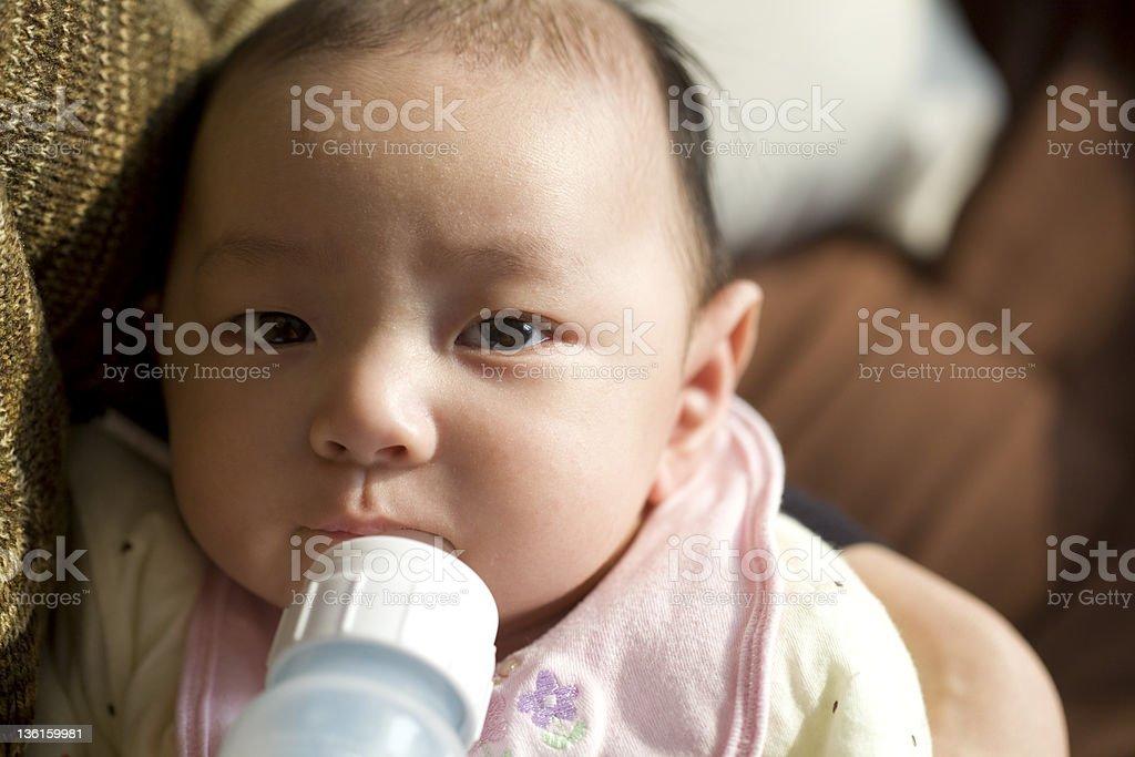 Chinese baby boy drinking milk bottle royalty-free stock photo