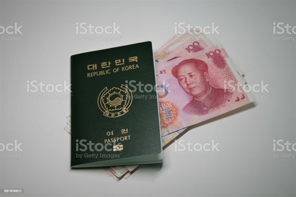 Chinese bank notes and passport stock photo