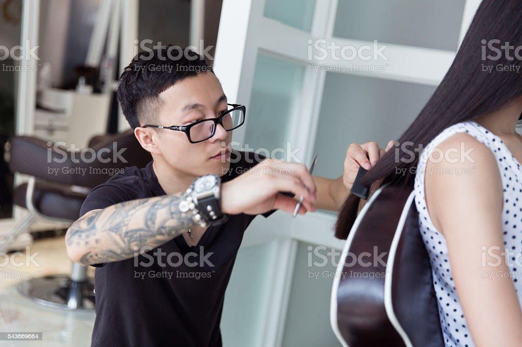 chinese barber trim long hair stock photo
