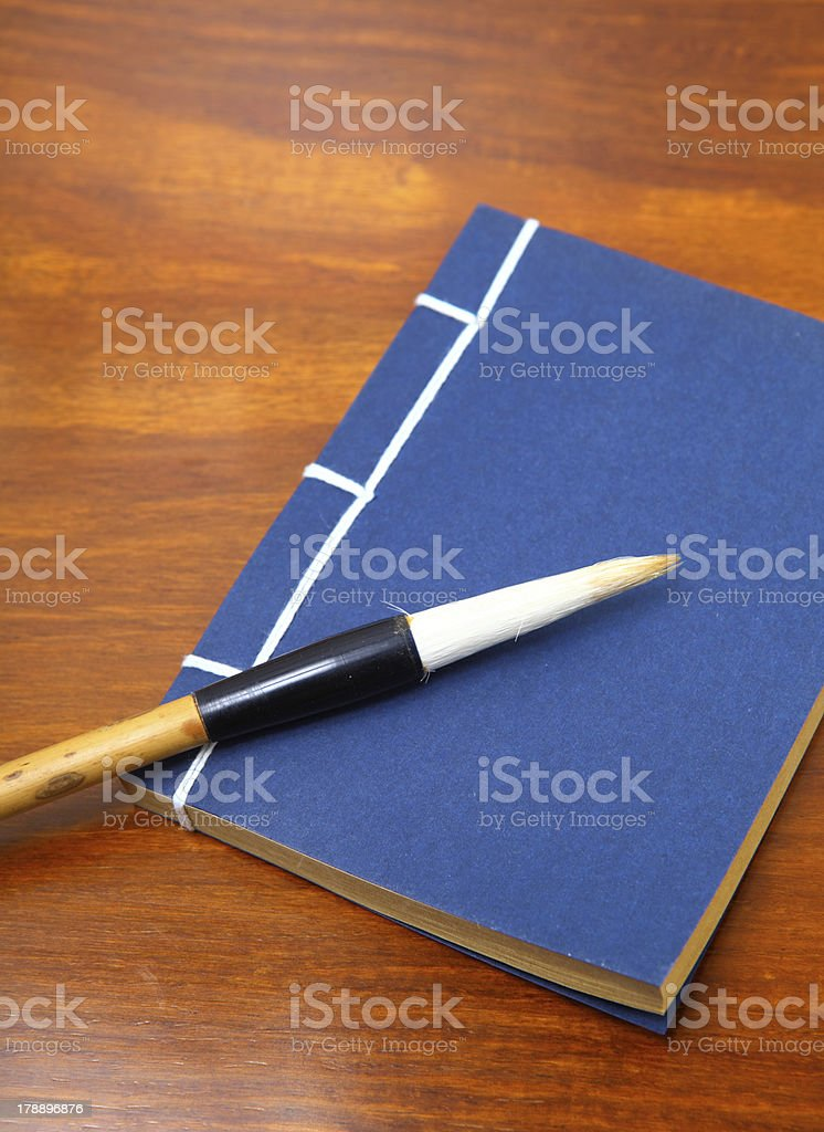chinese book and writing brush stock photo