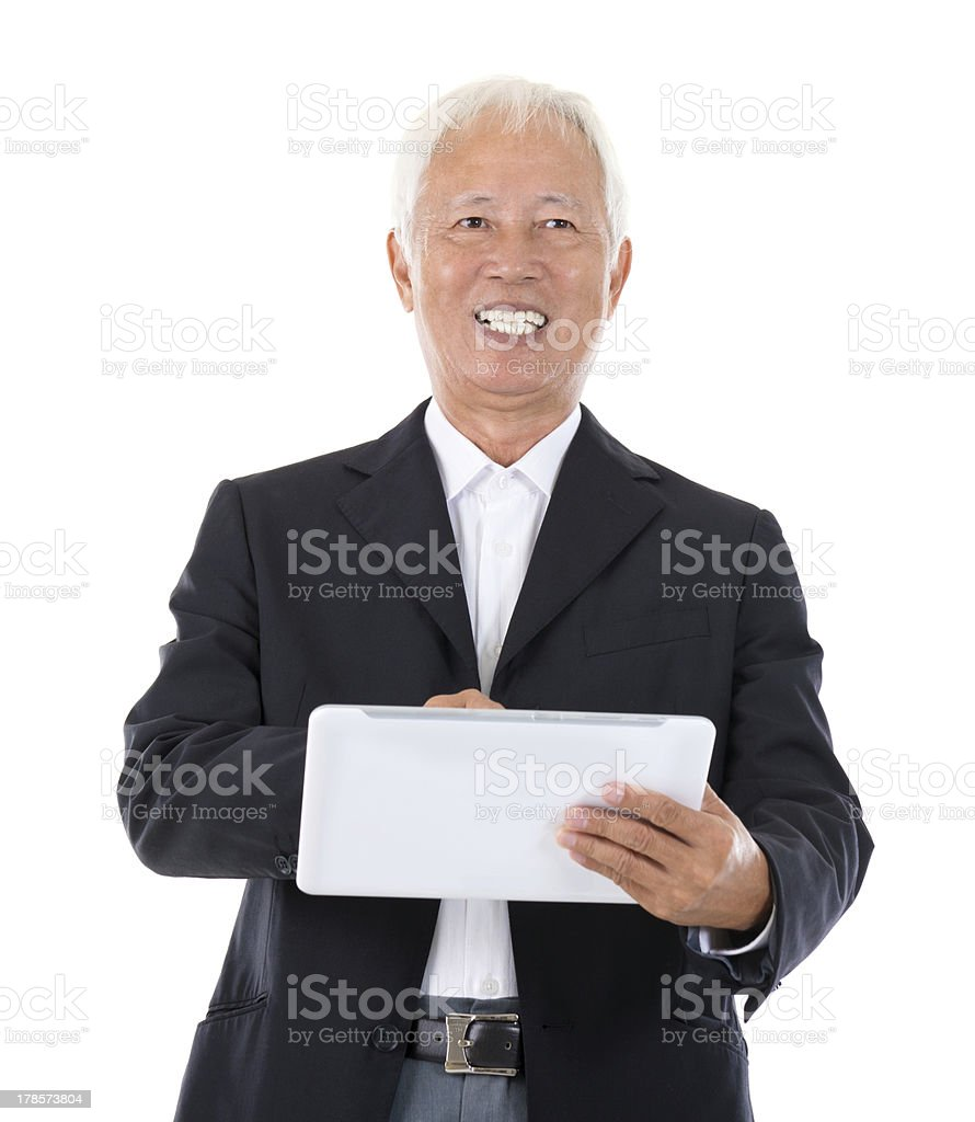 Chinese boss using tablet-pc royalty-free stock photo