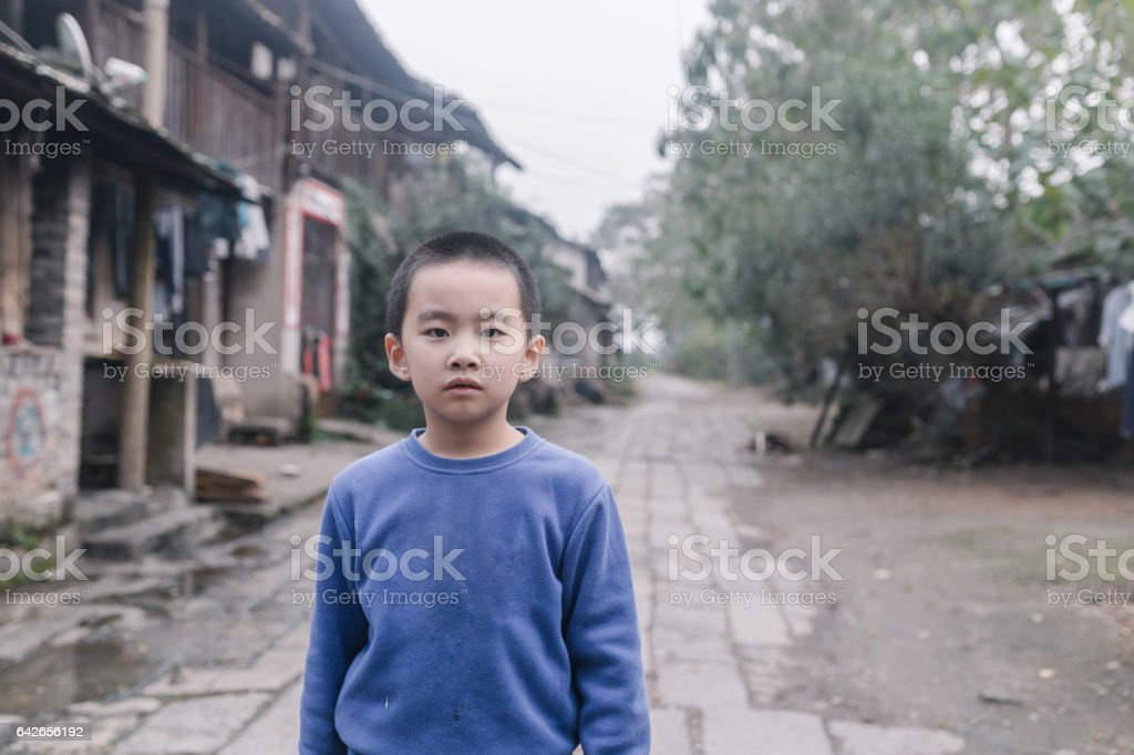 chinese boy in the old lane stock photo