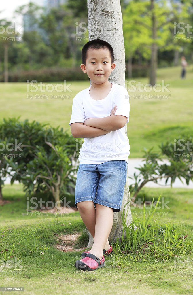 Chinese boy in the park royalty-free stock photo