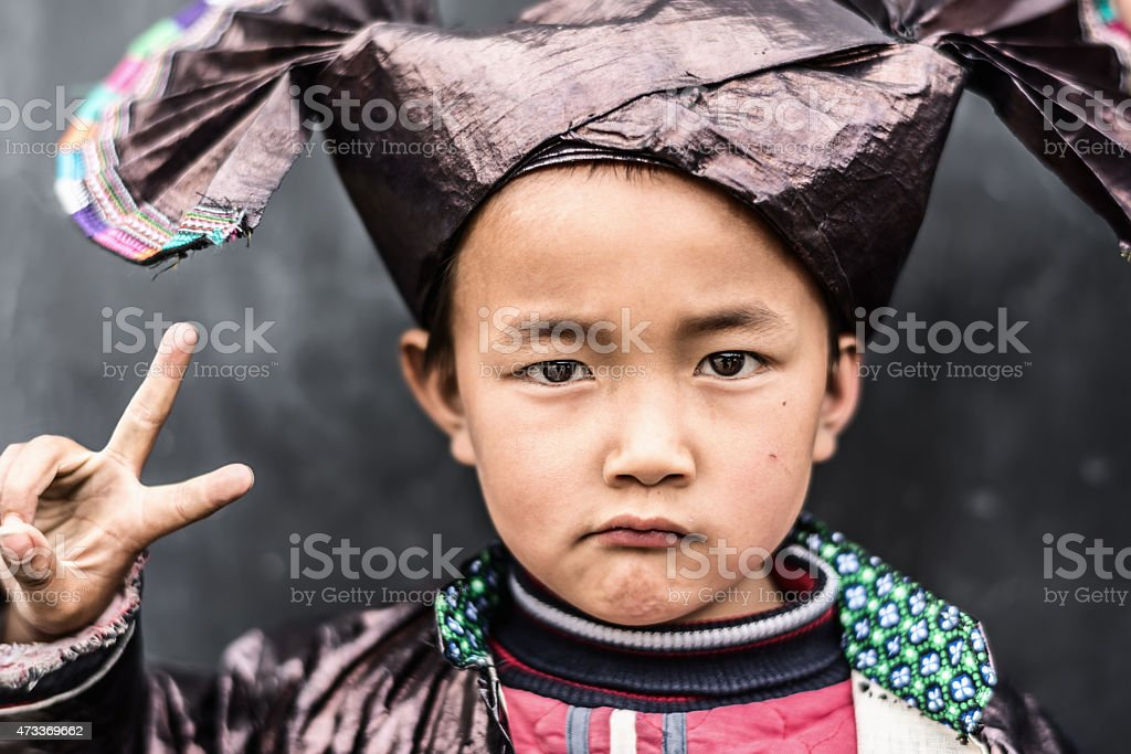 Chinese Boy in Traditional Dong Clothing stock photo