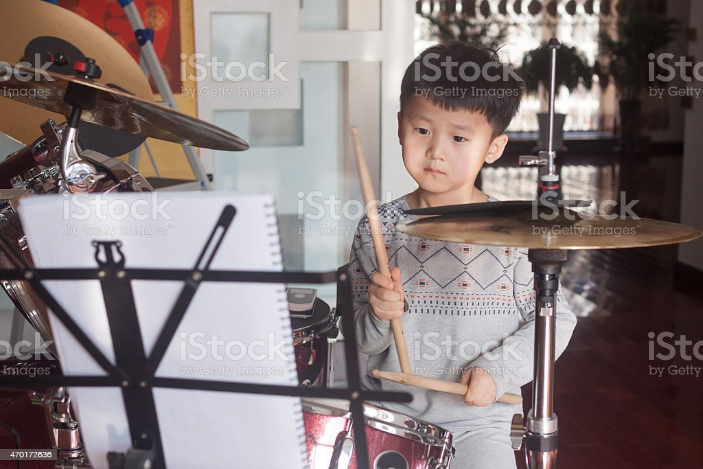 Chinese boy playing drums stock photo