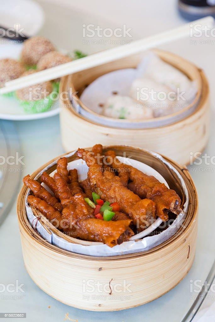 Chinese braised Chicken Feet Dim Sum in Bamboo Steamer stock photo