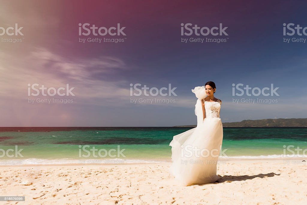 Chinese bride on the beach. stock photo