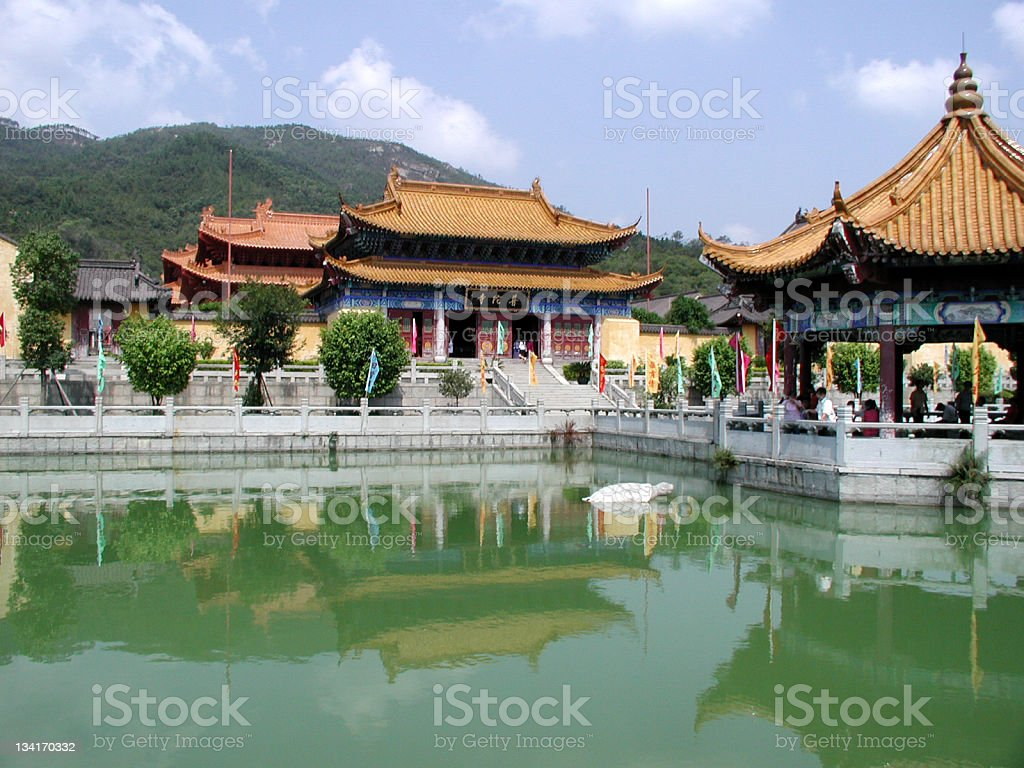Chinese buddhist temple with lake and mountain stock photo