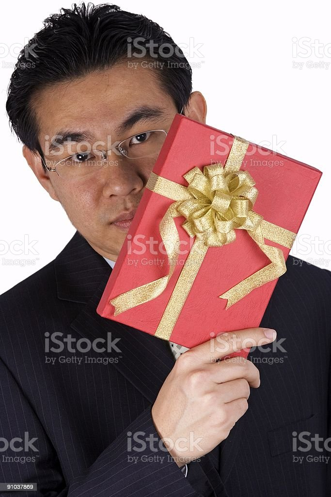Chinese Businessman holding Present royalty-free stock photo