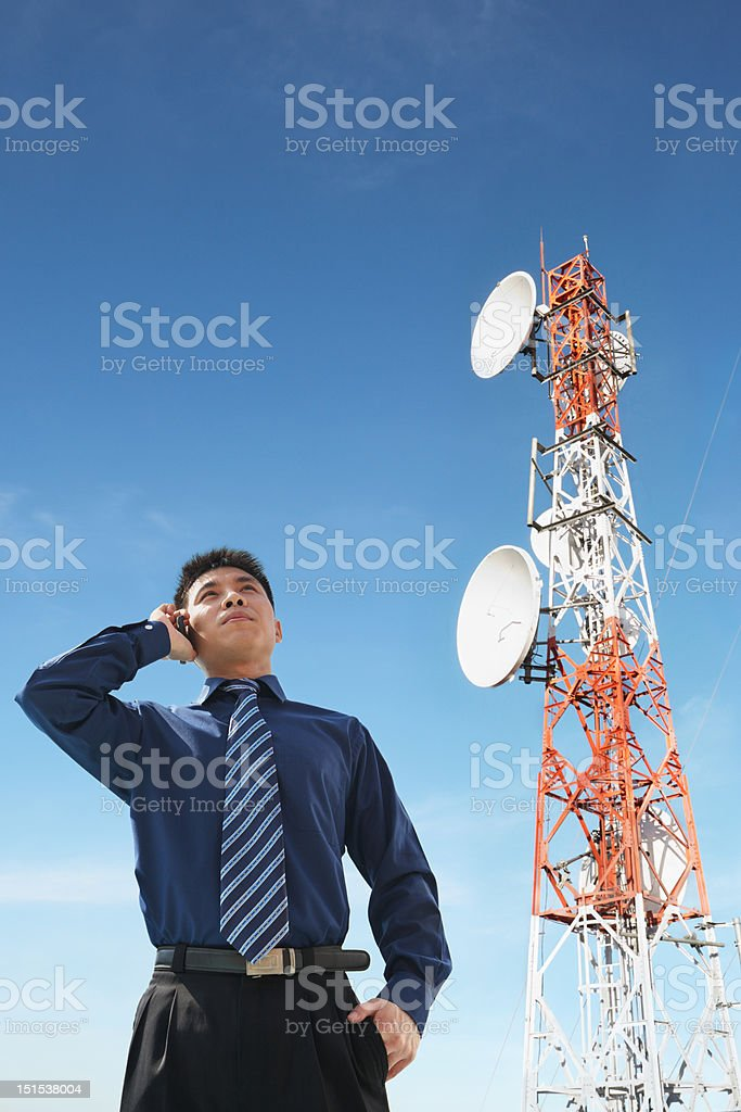 Chinese businessman on phone and antenna royalty-free stock photo