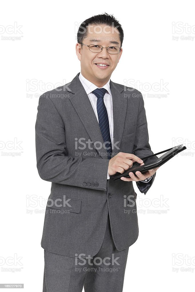 Chinese Businessman Using Digital Tablet royalty-free stock photo