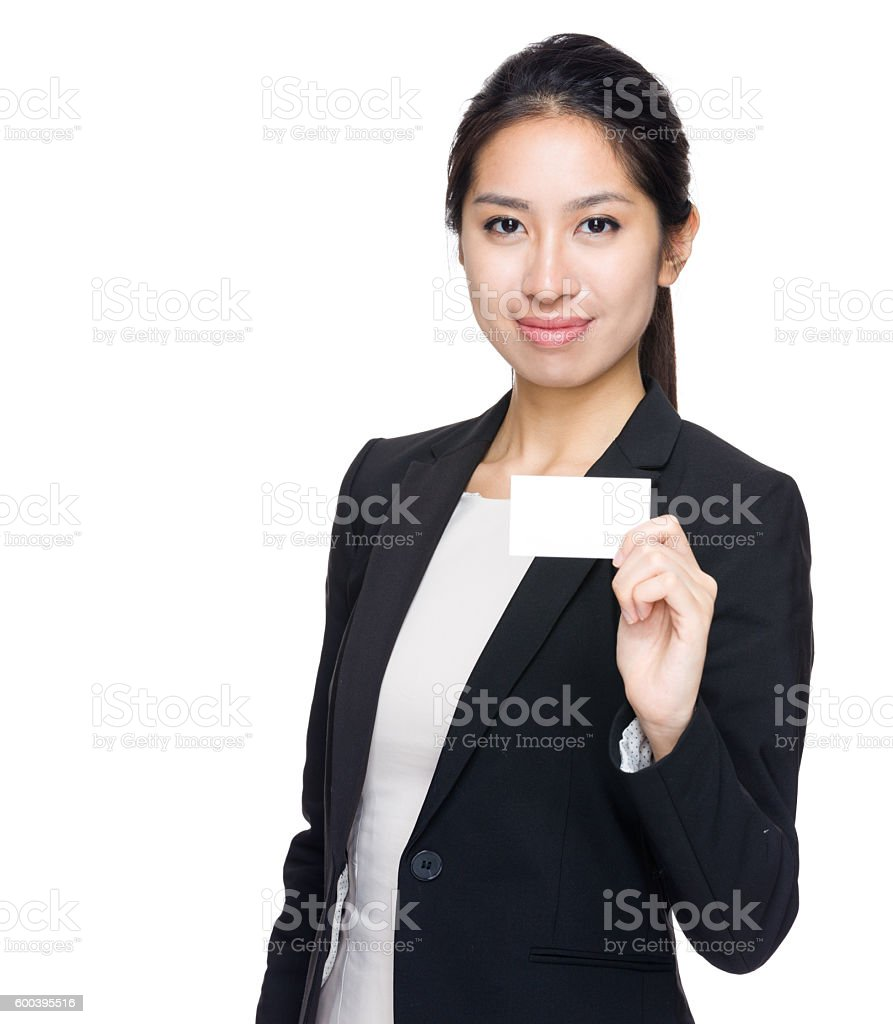 Chinese businesswoman holding a blank name tag stock photo