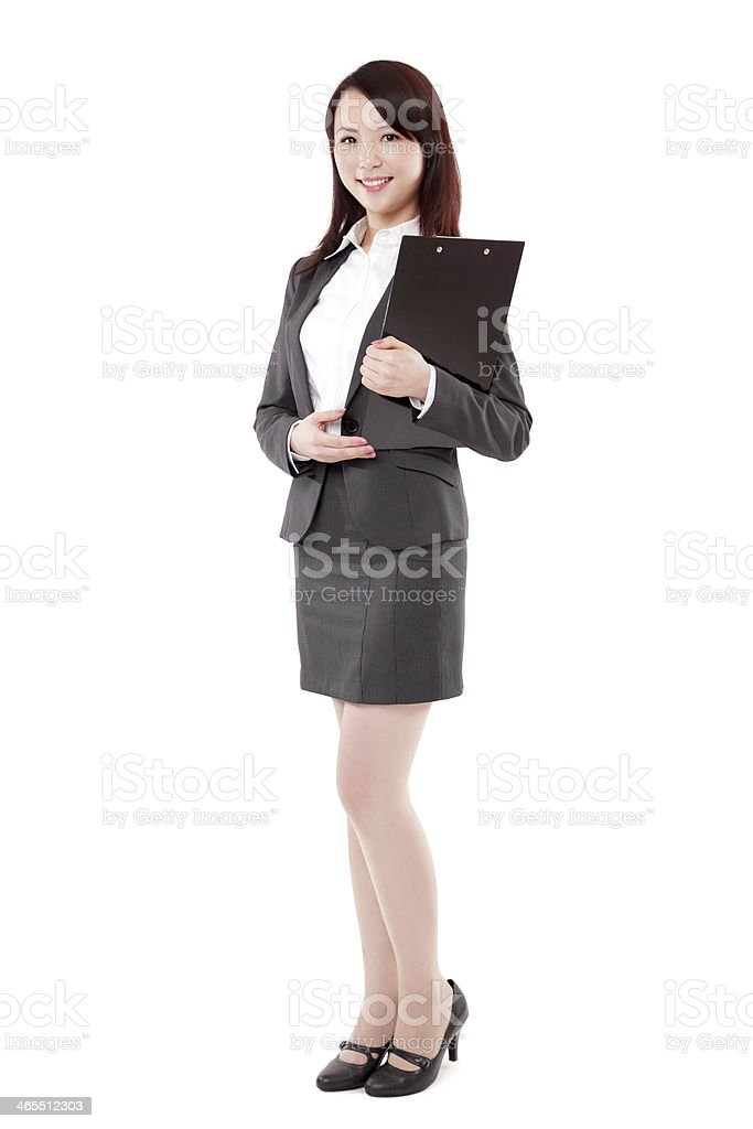 Chinese Businesswoman Standing and Holding Clipboard on White Background stock photo