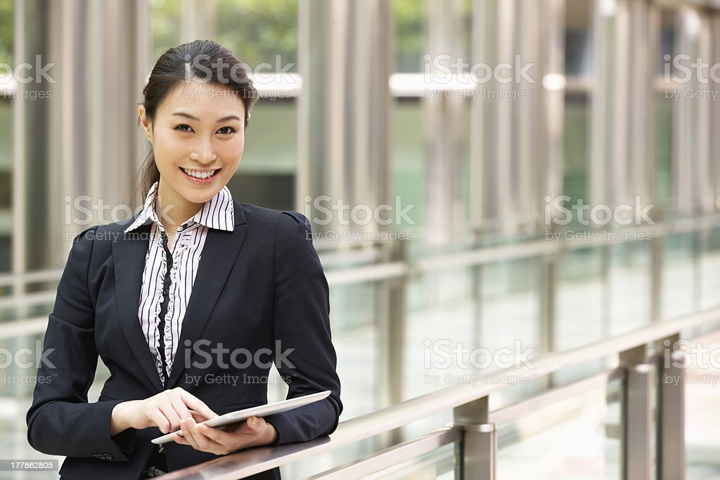 Chinese businesswoman using a tablet outside of the office stock photo