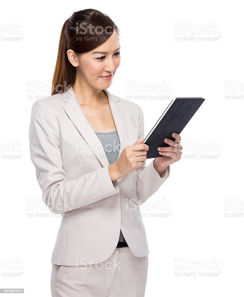 Chinese businesswoman using a tablet stock photo
