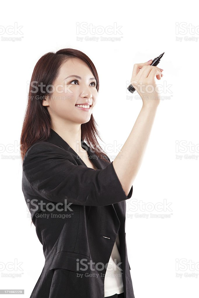 Chinese Businesswoman Writing with Felt Tip Pen Smiling White Background stock photo