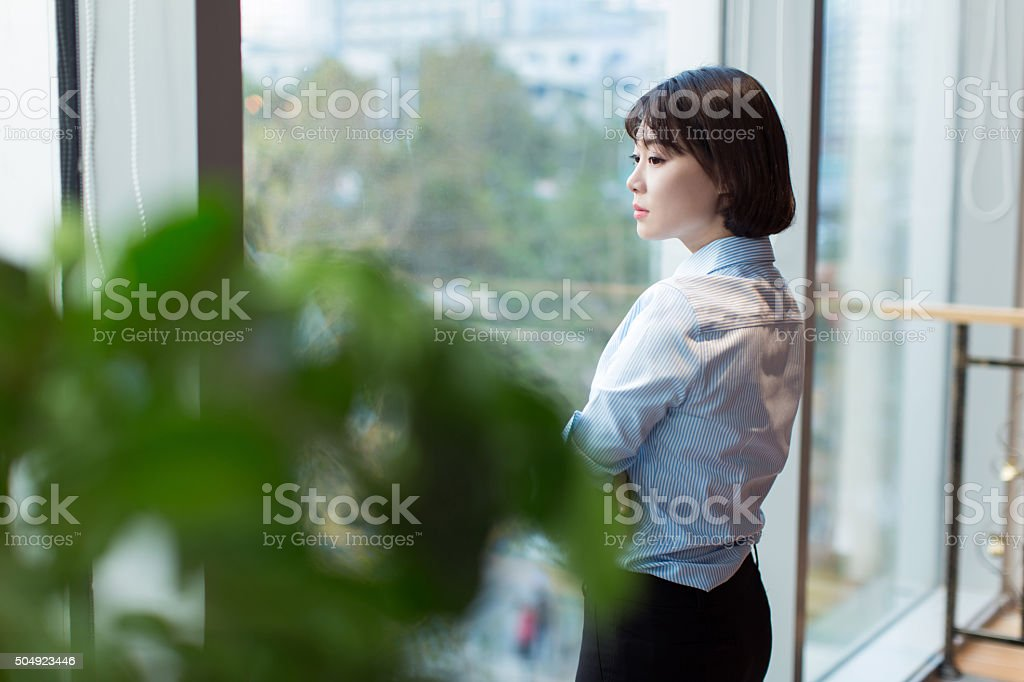 chinese career woman, wearing a shirt stock photo