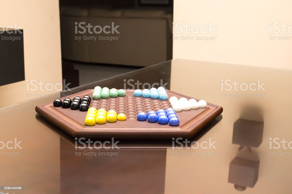 Chinese checkers set in living room stock photo