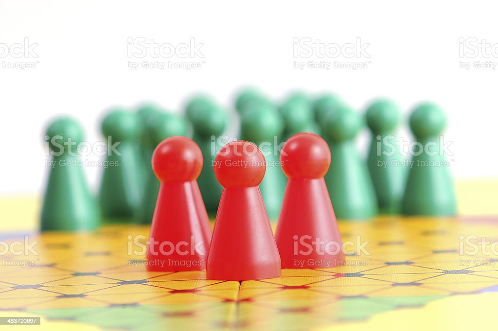 chinese checkers with pawn in conflict situation stock photo