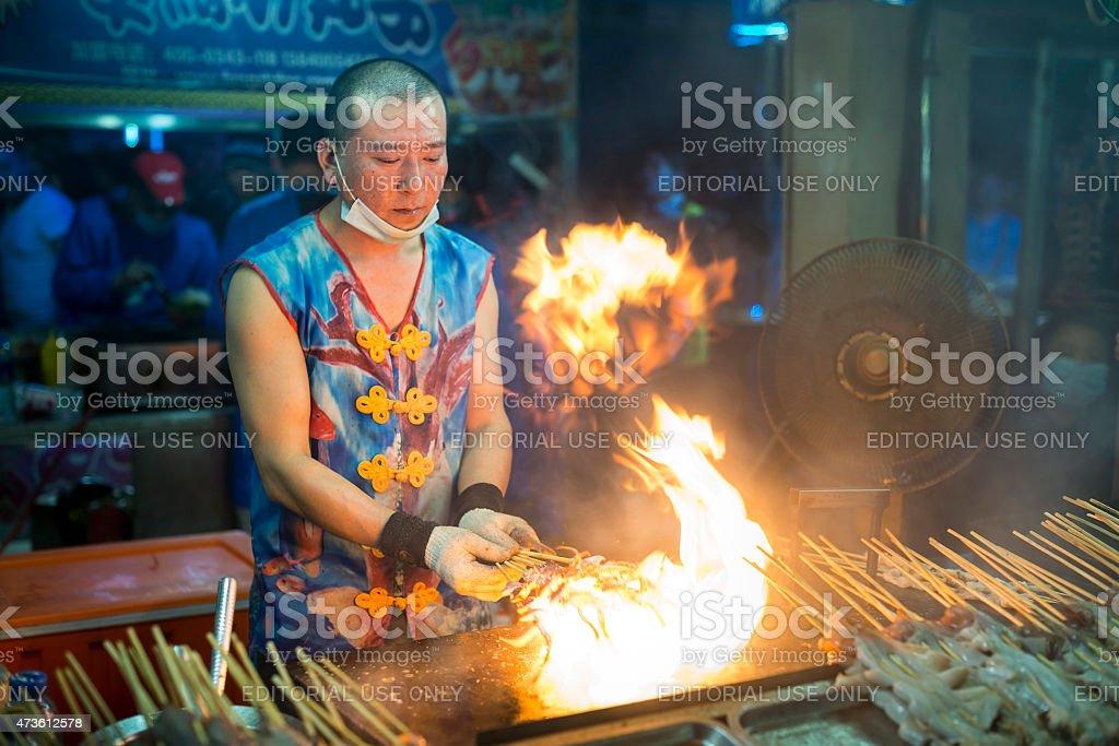 Chinese chef making Fire Iron Squid stock photo