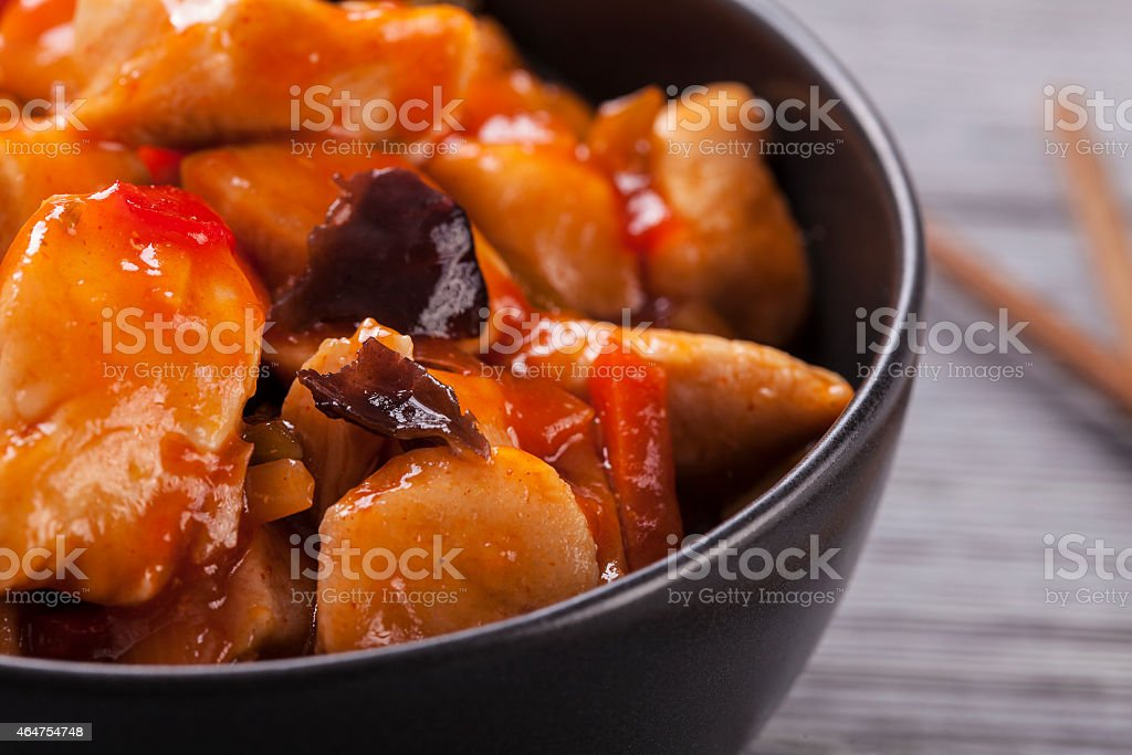 Chinese chicken sweet and sour sauce stock photo