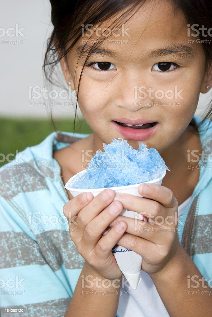 Chinese child with blue snow cone stock photo