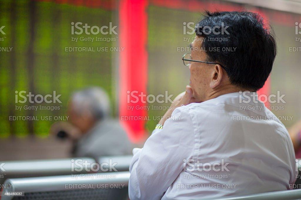 Chinese Citizens Watching Stock Market, Beijing 2015 stock photo