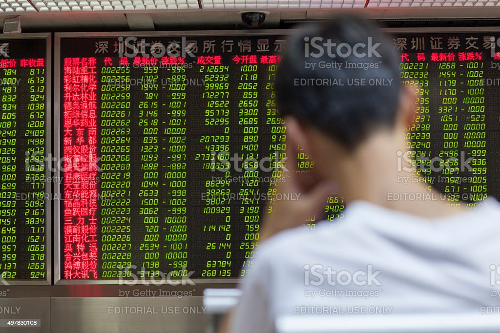 Chinese Citizens Watching Stock Market, Beijing 2015 stock photo