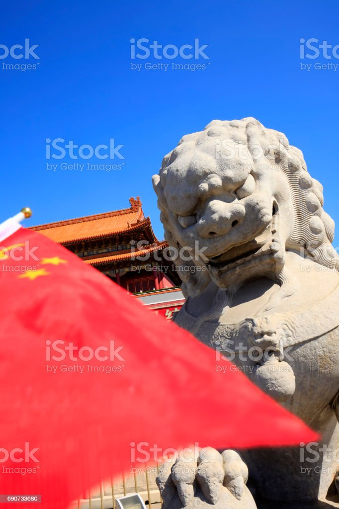 Chinese classical architecture and stone lions stock photo