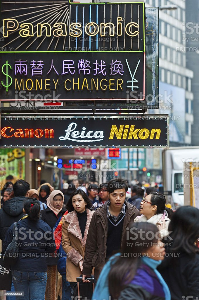 Chinese consumers on busy shopping street Hong Kong royalty-free stock photo