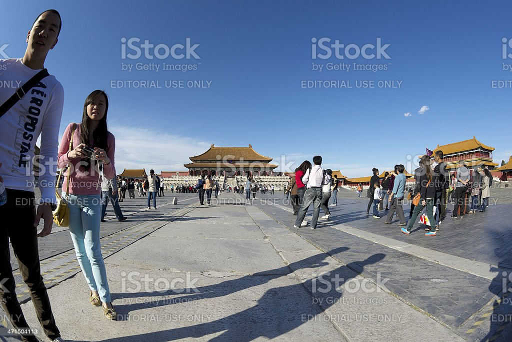 Chinese couple approaching photographer in the Forbidden City stock photo