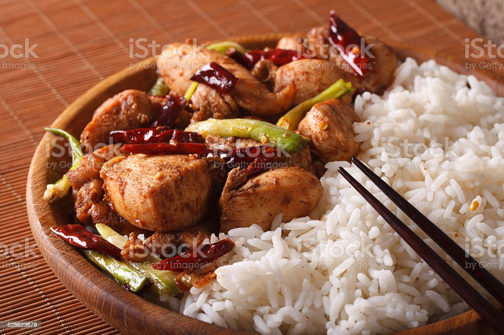 Chinese Cuisine: kung pao chicken and rice close-up. horizontal stock photo