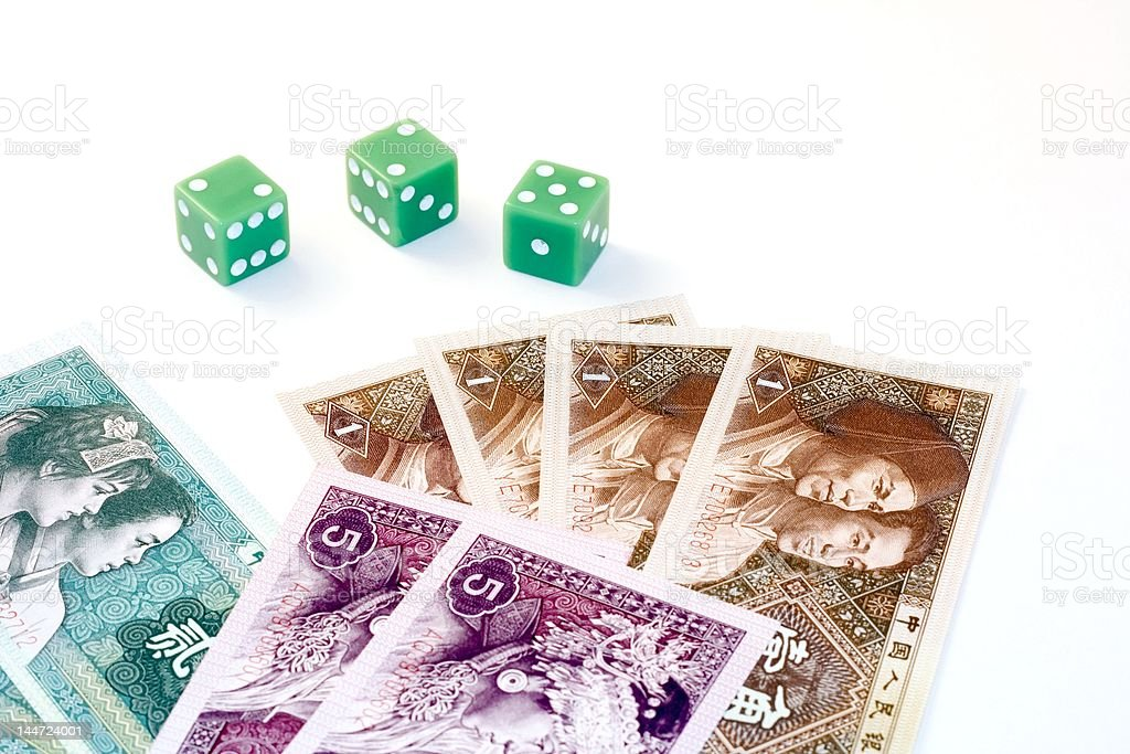 Chinese currency and dice stock photo